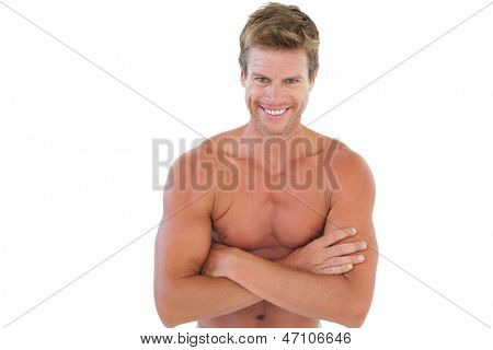Shirtless man with arms crossed on white background