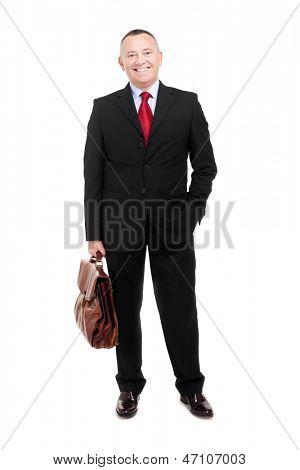 Elder businessman holding a briefcase
