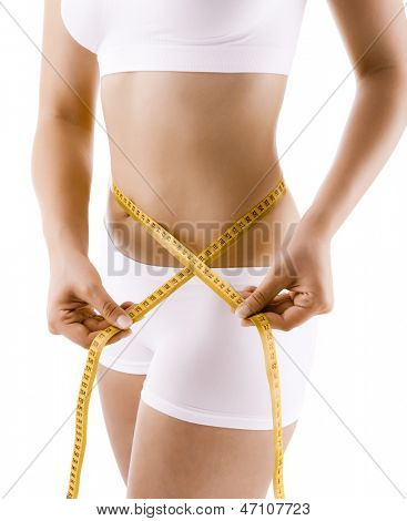 Woman measuring her waist body isolated on white background