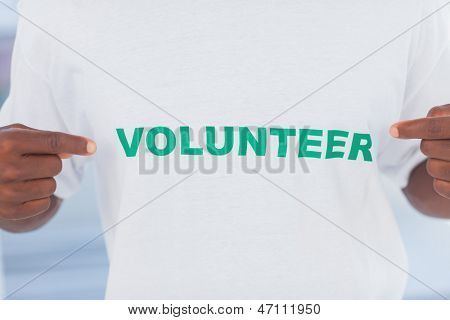 Man wearing volunteer tshirt in a modern office