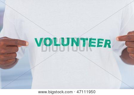 Man wearing volunteer tshirt in a modern office