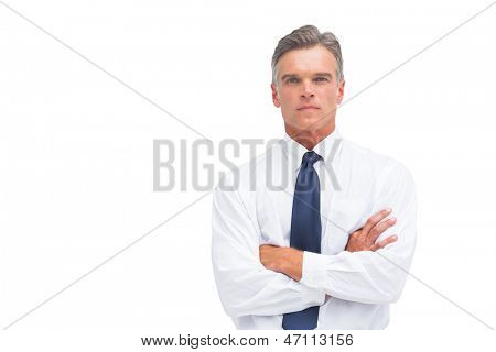 Stern businessman with crossed arms looking at the camera