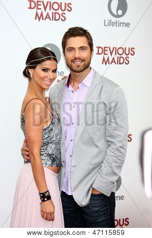 "LOS ANGELES - JUN 17:  Roselyn Sanchez, Eric Winter arrives at the ""Devious Maids""  Lifetime's Original Series Premiere at the Bel-Air Bay Club on June 17, 2013 in Pacific Palisades, CA"