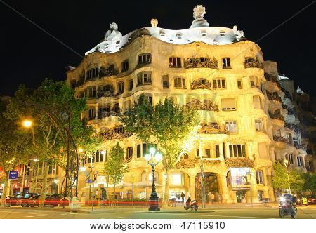 BARCELONA - MAY 7 : Casa Mila or La Pedrera on May 7, 2013 in Barcelona, Spain. This famous building was designed by Antoni Gaudi and is one of the most visited of the city.