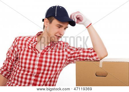 Handsome young caucasian courier with brown box over white background