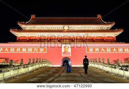 BEIJING, CHINA - APR 1: Tiananmen exterior with guard at night on April 1, 2013 in Beijing, China. It is a famous monument in Beijing and serves as a national symbol.