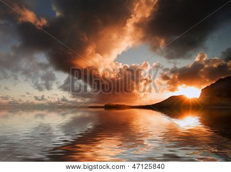 Sunrise And Mountains Refelcted In Sea