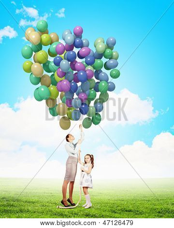 Image of little cute girl and mother with bunch of color balloons