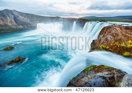 Godafoss is a very beautiful Icelandic waterfall. It is located on the North of the island not far from the lake Myvatn and the Ring Road. This photo is taken after the midnight sunset