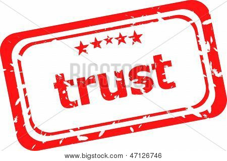Trust Red Rubber Stamp Over A White Background