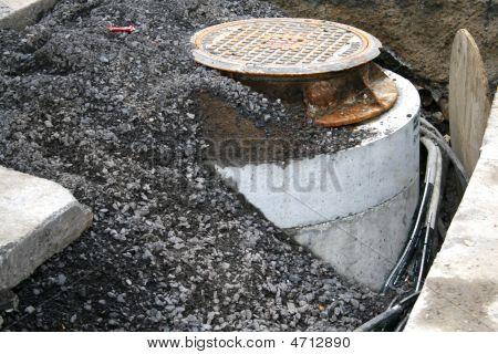 Gravel Over The New Manhole