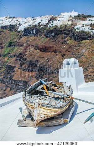 Famous Old Boat On The Roof Of House The Background Of Imerovigli