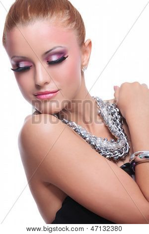 closeup of a young beauty woman looking down over her shoulder. on white background
