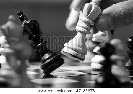 playing wooden chess pieces close up