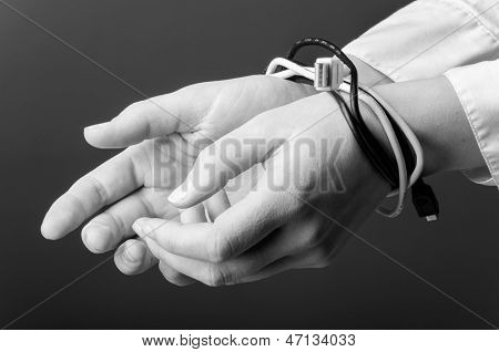 female hands are tied up with computer cables