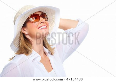 Senior Woman wearing sunglasses and a hat. Summer vacation.
