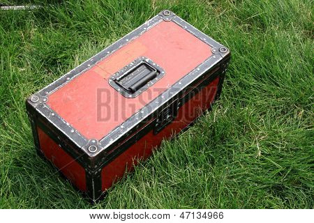 Red Tin Box On A Green Lawn