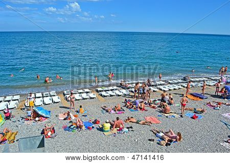 Alushta, Ukraine - Jun 01: People On The Beach In Alushta, Ukraine On June 01, 2013.