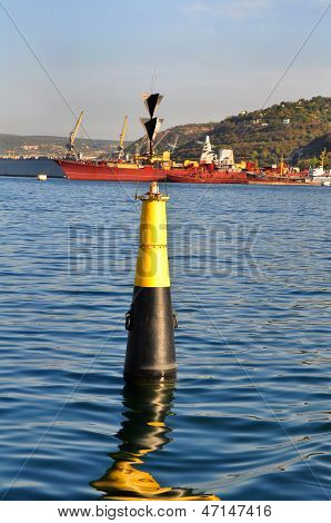 Black and yellow buoy
