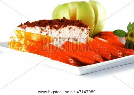 cream cake, raw apple, and strawberry on plate
