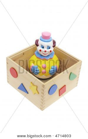 Toy Clown In Wooden Box