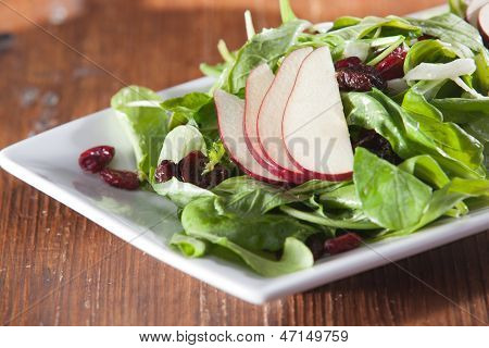 Fresh raw spinach salad with fruit