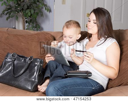 Mother and toddler shopping from home