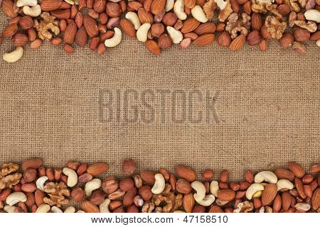 Mixture Of Nuts Lying On Sackcloth