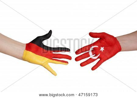 Hands With German And Turkey Flag