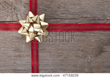 Red Ribbon With Golden Bow
