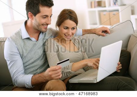 Couple using credit card to shop on internet