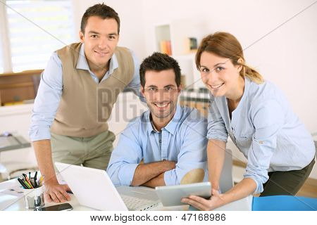 Smiling business team looking at camera