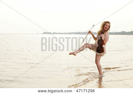 Happy Blonde Girl With A Violin Outdoor