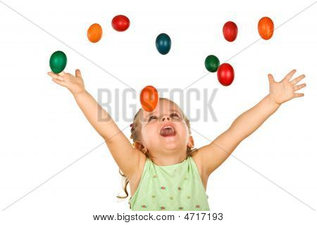 Happy Shouting Little Girl With Falling Easter Eggs