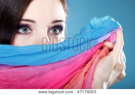 Woman Hides Her Face With Shawl
