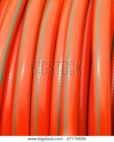 Rolled Up Of Orange Plastic Hose
