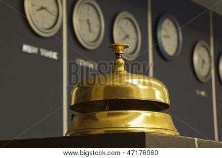 Old Hotel Bell With Watch In Background