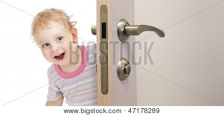 happy kid behind door