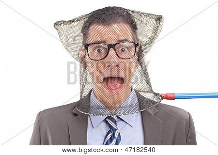 Scared businessperson caught in a fishing net, isolated on white background