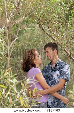 Loving Couple Is Embracing Outdoors