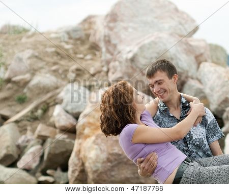 Man Is Holding His Wife On Hands Outdoors
