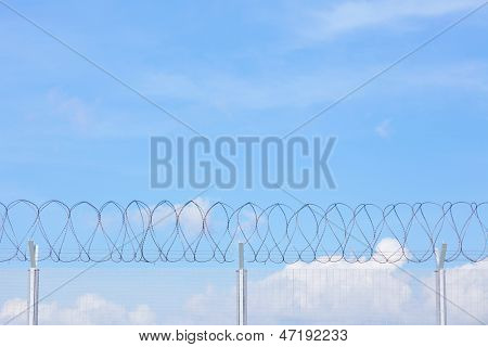 Chain link fence with barbed wire