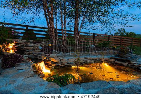 Decorative pond at night