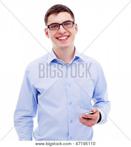 Smiling young business man in blue shirt holding phone in left hand. Isolated on white background, mask included