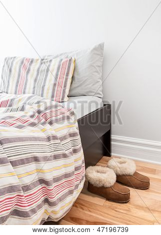 Warm Cozy Slippers Near Bed