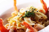 foto of tiger prawn  - Fresh italian seafood pasta served with shrimps - JPG
