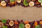 pic of mixture  - Mixture of dried fruits lying on sackcloth space for text - JPG
