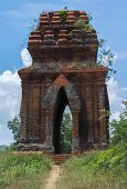 stock photo of champa  - Vietnam blue skies as seen through one of the Banh It Cham towers - JPG
