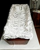 picture of empty tomb  - the empty opened coffin in the graveyard - JPG