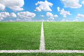 stock photo of football pitch  - Football And Soccer Field Grass  blue sky background - JPG